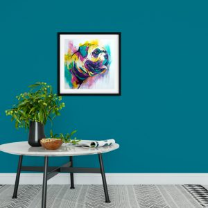 French Bulldog print with a black frame in a modern room setting with teal walls